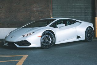 White Lamborghini Huracan in industrial zone